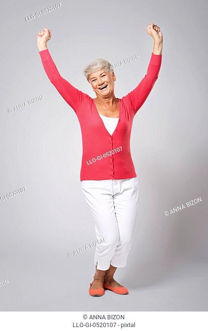 Senior beautiful woman celebrating success. Debica, Poland