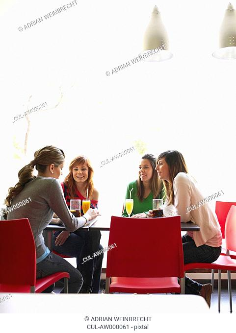 Group of teenage females in cafe
