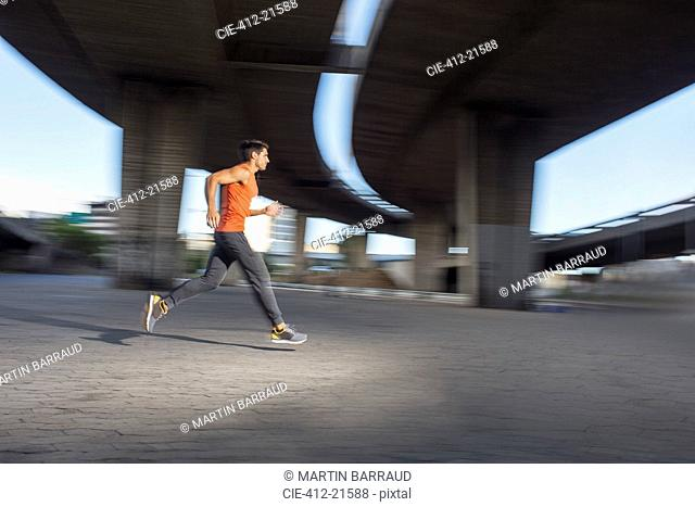 Man running through city streets