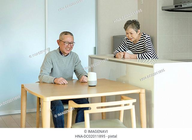 Senior couple interested in AI speaker