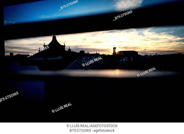 Bell towers of the Santa Maria and Carme churches, seen through window blinds. Mahó, Minorca, Balearic Islands, Spain