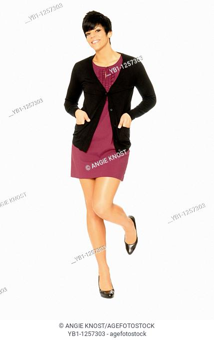 Attractive woman in burgundy dress and black sweater or jumper, on white background