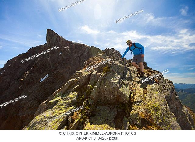 Hiker climbing down from Lady Peak mountain in Cheam Mountain Range