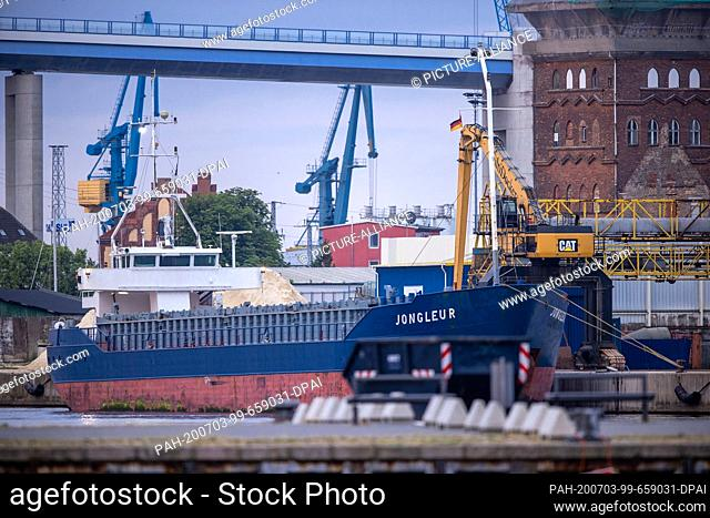 """30 June 2020, Mecklenburg-Western Pomerania, Stralsund: The coaster """"""""Jongleur"""""""" is loaded in the harbour of Stralsund. The almost 80 meter long ship is mainly..."""