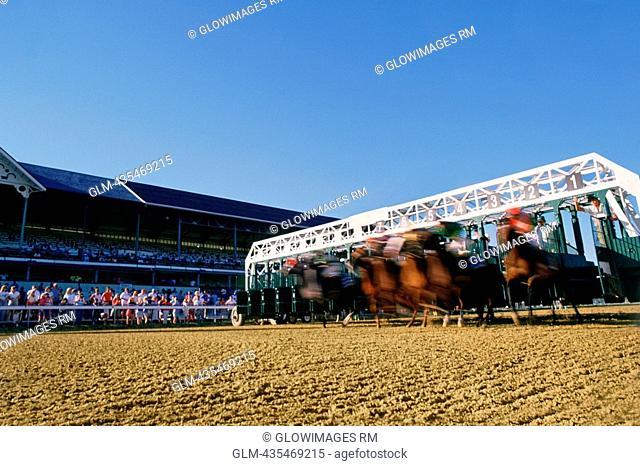 Jockeys riding their horses on a running track
