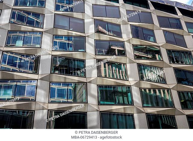 A modern high rise with glass front in London, city of London, England, Great Britain