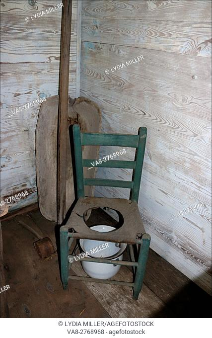 A child's commode chair has seen better days at Laura Plantation, in Vacherie, Louisiana, USA