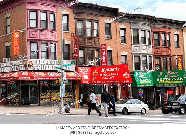 Colored row house and Deli restaurants in Bedfordpark neighbourhood. Northwest Bronx, New York, U.S.A