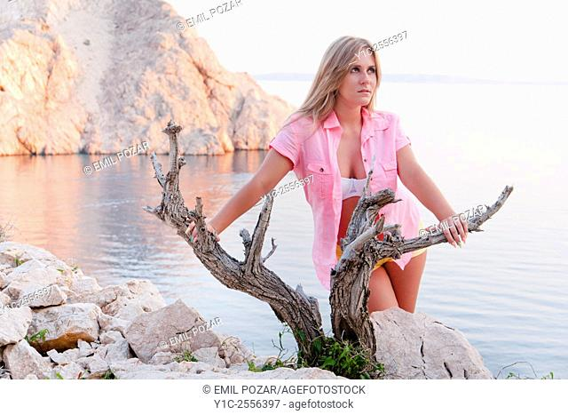 Young woman before Zavratnica-bay in Croatia