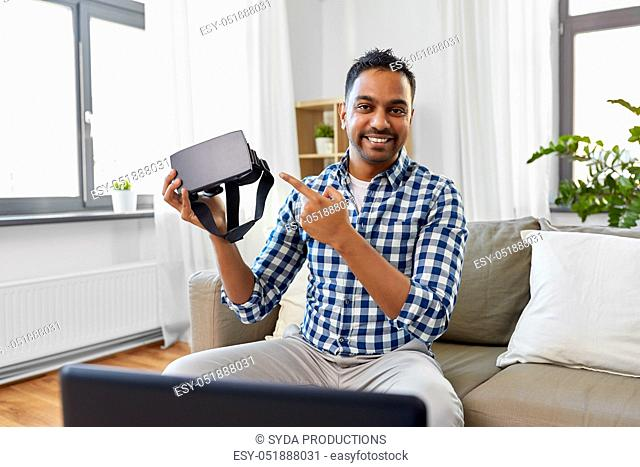 male blogger with vr glasses videoblogging at home
