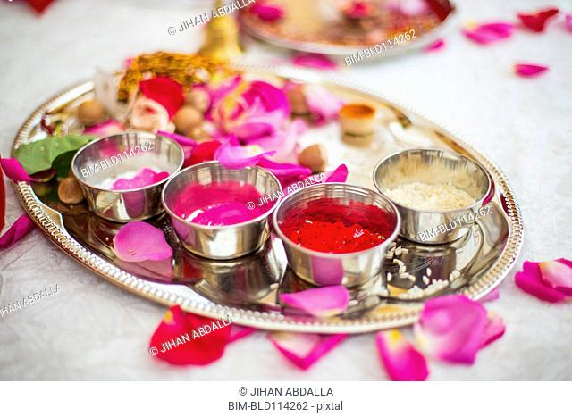 Silver tray of sauces on table