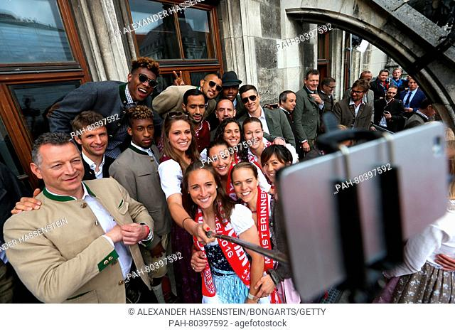 MUNICH, GERMANY - MAY 15: Players of Bayern Muenchen women's and men's team celebrate winning the German Championship title on the town hall balcony at...