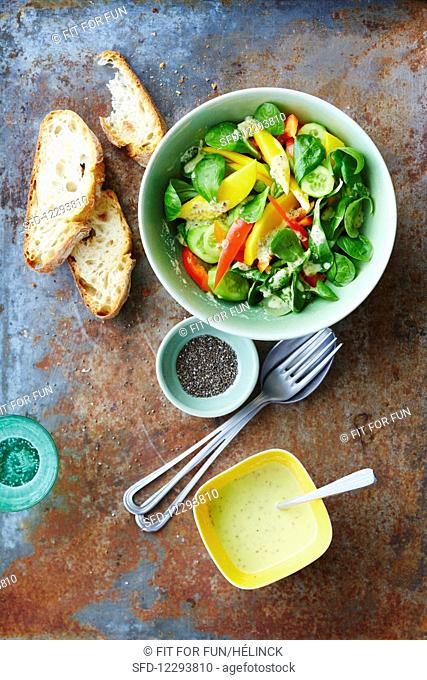 Lamb's lettuce with mango and chia dressing