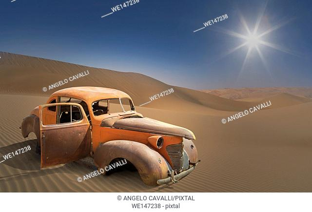 Old rusty car abandoned in the desert, Namibia
