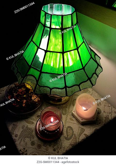 Green lamp and two candles, Montreal, Canada
