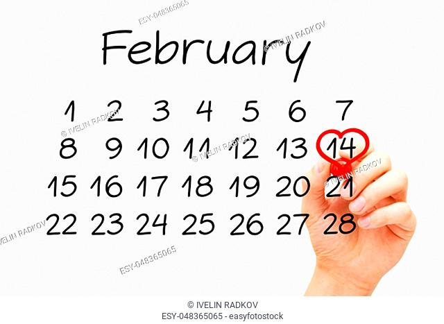Hand drawing a red heart on calendar date February 14 with marker on transparent glass board. Valentines Day concept
