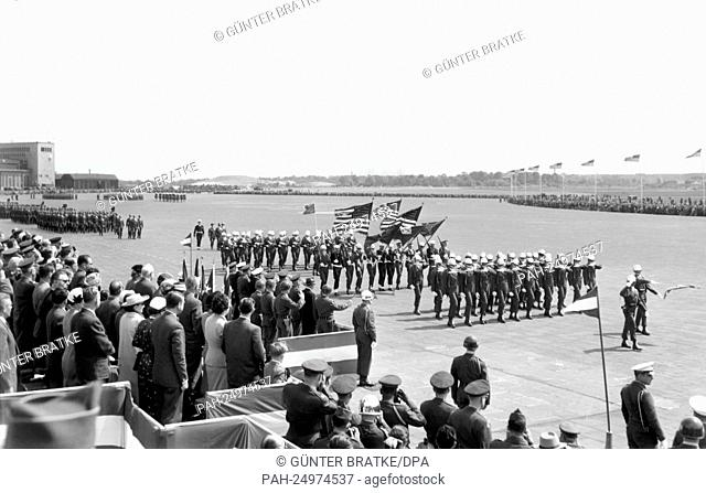 Soldiers of the US Army marching past a VIP stand at airport Tempelhof in Berlin on occasion of a parade for the 'Armed Forces Day' on 16th May 1953