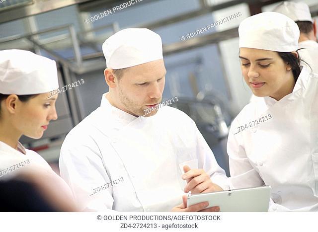 People working in restaurant kitchen