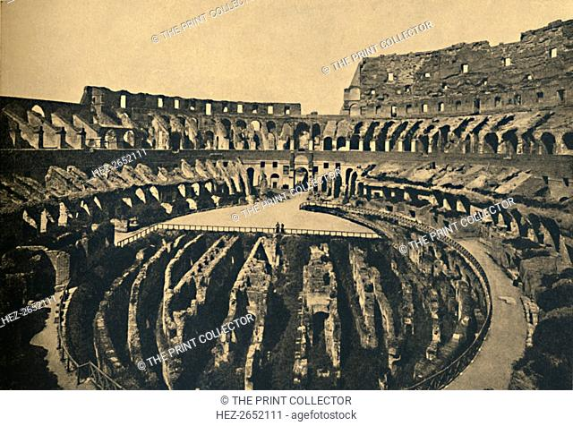 'Roma - Flavien Ampitheatre', 1910. Interior showing remains of the four tiers of seats and arena 302 feet long and 194 ft broad'