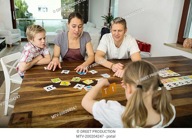 Family at living room playing parlor game together