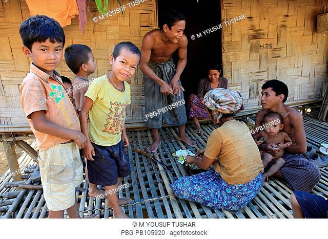 An ethnic family at Tindu Bandarban, Bangladesh December 2009