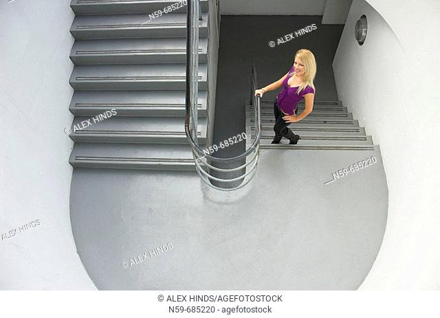 Young blonde woman on stairs