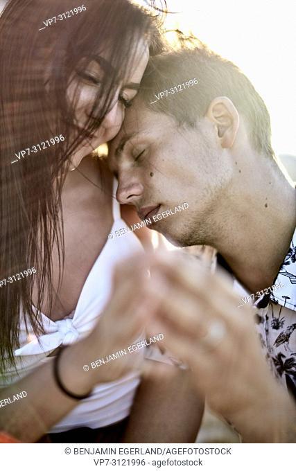 boyfriend leaning on shoulder of girlfriend, sensual, couple, love, emotions. Chersonissos, Crete, Greece