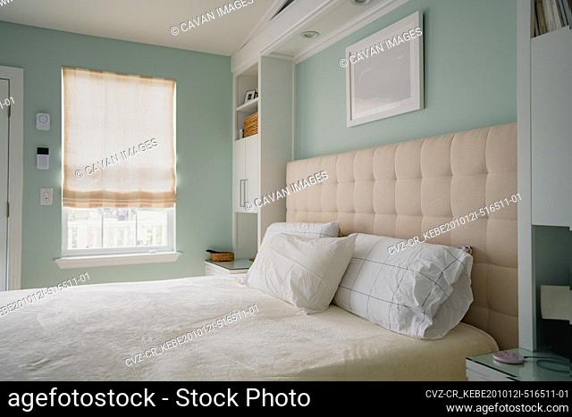 clean bedroom interior with beige and green color scheme