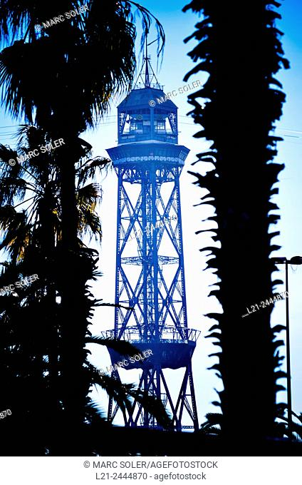 Cable car tower between palms. Barcelona, Catalonia, Spain