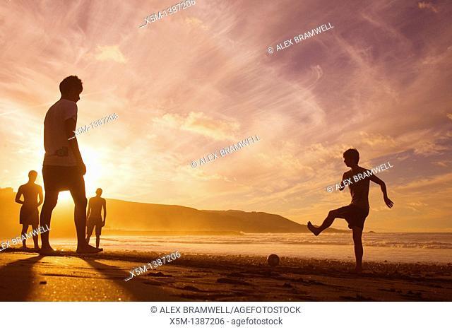 Boys playing football on the beach at sunset  Las Canteras beach in Las Palmas de Gran Canaria