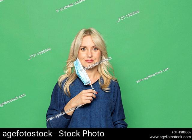 Portrait beautiful blonde woman with protective face mask