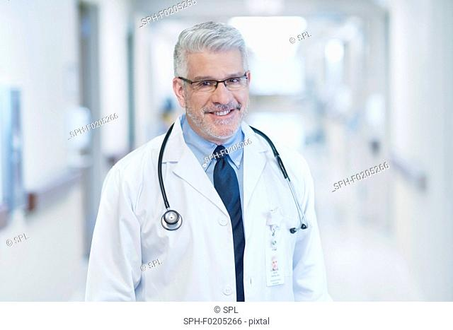 Mature male doctor wearing glasses