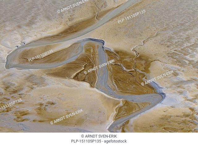 Aerial view of stream running through tidal mudflat at the Schleswig-Holstein Wadden Sea National Park, Germany
