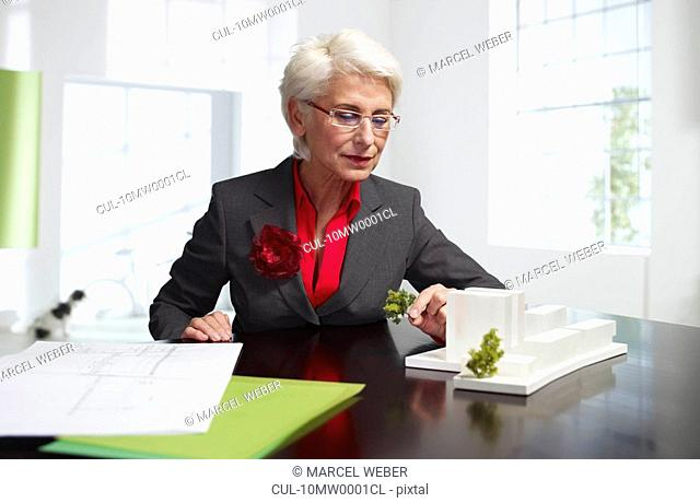 Female senior architect at work in loft