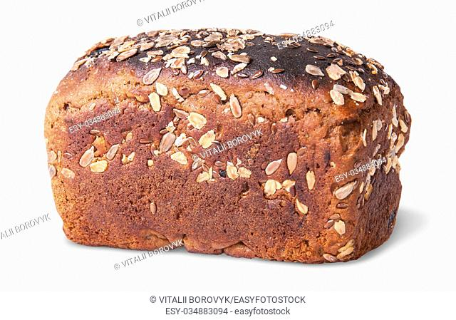 Unleavened black bread with nuts seeds and dried fruit rotated isolated on white background