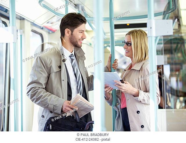 Business people talking on train