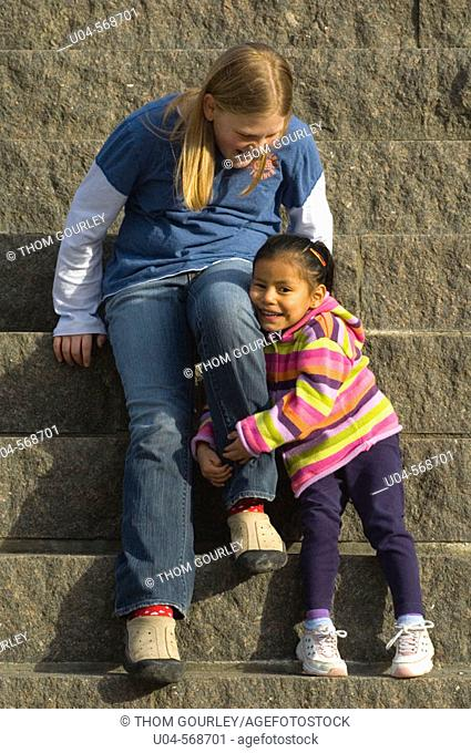 Happy sisters [Caucasian and Latina] from ethnically mixed family
