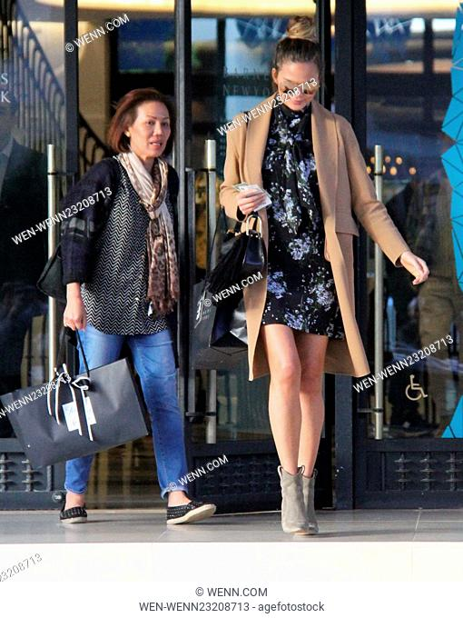 Pregnant Chrissy Teigen shopping at Barneys New York in Beverly Hills wearing a camel coat Featuring: Chrissy Teigen Where: Los Angeles, California