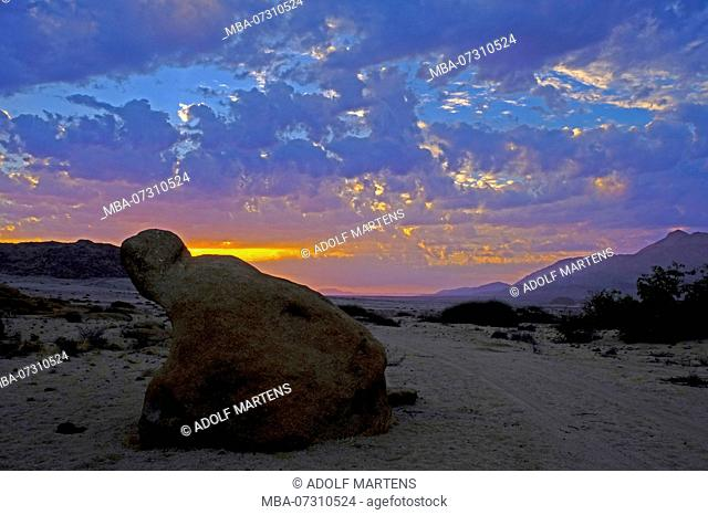 moody sunset with clouds in the desert-like, rocky Brandberg area in Namibia, Damaraland