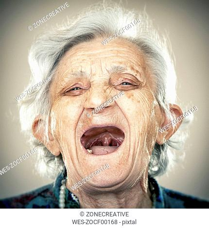 Portrait of an elderly lady, laughing out loud