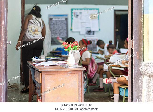 Teacher and school children in classroom, Havana, Cuba