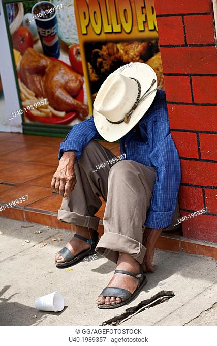 Guatemala, Rabinal, man sleeping on sidewalk