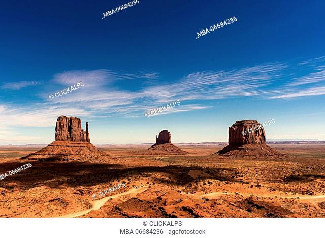 Monument Valley National Park, Utah, Arizona, Usa. The famous rock formations of the Mittens and the Merrick Butte