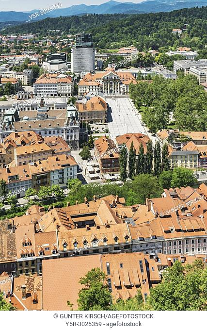 View over the old town of Ljubljana to the square Kongresni trg (Congress Square). At the Congress Square are the buildings of the Trinity Church