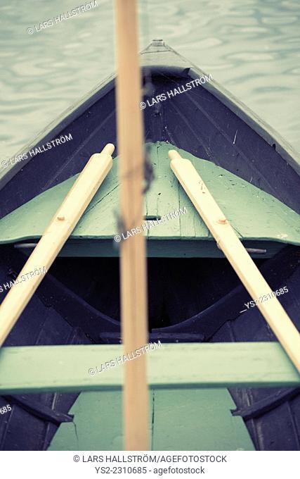 Empty wooden boat with oars