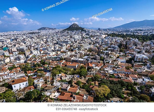 Aerial view from Acropolis of Athens city on Plaka historical district, Greece. Mount Lycabettus seen on photo