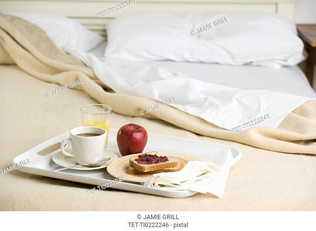Still life of breakfast tray on bed