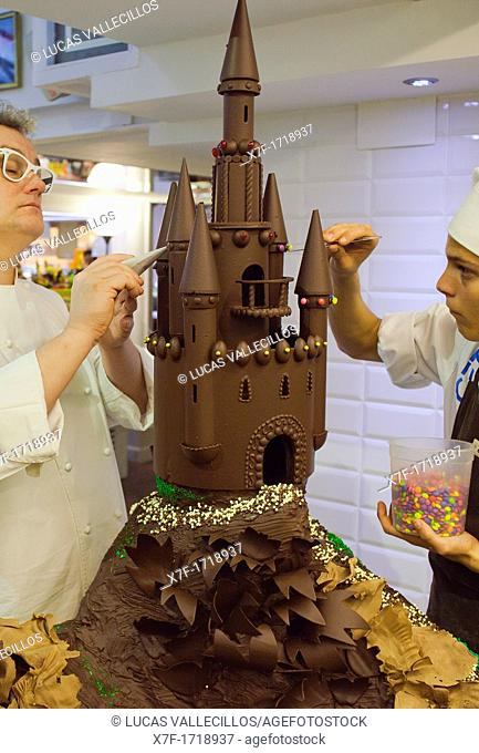 Christian Escriba and an assistant making a 'Mona', typical chocolate cake of Pascua's monday, the godfather gives his godson, catalan tradition, Escriba bakery