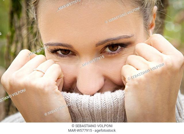woman with turtleneck sweater