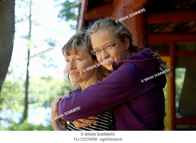 Mother and daughter in an embrace; Lac des Neiges, Quebec, Canada